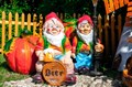 Садовая фигурка полистоун Гном на бочке - фото 37255
